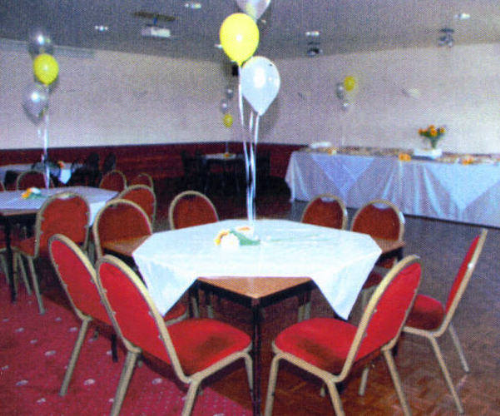 Function room made ready for a party.