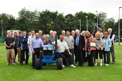 KSC Chairman Steve Mockett with KCC Players and residents accepting our new Tractor from Mr and Mrs Brooks