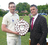 Bourne captain Pete Morgan is presented with the Winkowrth trophy by Martin Thompson of Winkworth